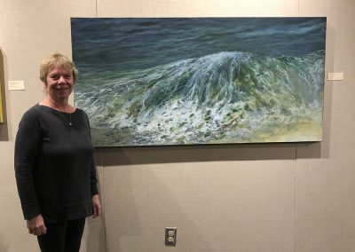 Sue Wilkins with her Honourable Mention painting Beach Break