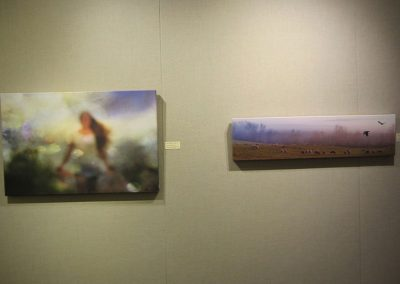 Carole Anne Bell-Smith's Lake Ontario Goddess 1 on left and Christopher Thorpe's Morning Has Broken - Juror's Choice