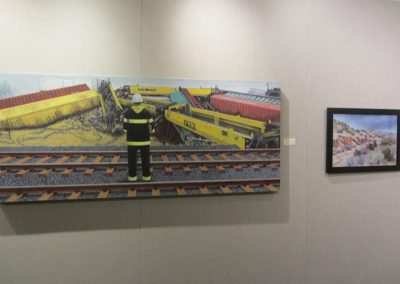 Edgar Hagedorn's Best in Show Derailment and Helen Van Poorten's Honourable Mention Arroyo